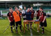 7 September 2019; Bohemians captain James Conroy is presented with the cup by Colm Young, FAI Senior Council Representative for Football For All, following the Megazyme Amputee Football League Cup Finals at Carlisle Grounds in Bray, Co Wicklow. Photo by Stephen McCarthy/Sportsfile