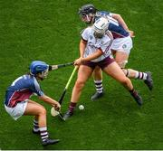 8 September 2019; Dervla Higgins of Galway in action against Laura Doherty, left, and Mairead McCormack of Westmeath during the Liberty Insurance All-Ireland Intermediate Camogie Championship Final match between Galway and Westmeath at Croke Park in Dublin. Photo by Ramsey Cardy/Sportsfile