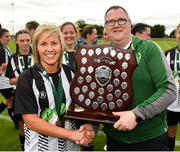 8 September 2019; Whitehall Rangers captain Charlie Graham is presented with the trophy by Derek Collins, FAI Women's Council, following the FAI Women's Intermediate Shield Final match between Manulla FC and Whitehall Rangers at Mullingar Athletic FC in Mullingar, Co. Westmeath. Photo by Seb Daly/Sportsfile