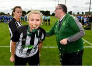 8 September 2019; Debbie Burnett of Whitehall Rangers celebrates with the medal following during the FAI Women's Intermediate Shield Final match between Manulla FC and Whitehall Rangers at Mullingar Athletic FC in Mullingar, Co. Westmeath. Photo by Seb Daly/Sportsfile