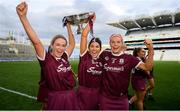 8 September 2019; Lorraine Ryan, left, Heather Cooney, centre, Sarah Dervan of Galway with the O'Duffy Cup following the Liberty Insurance All-Ireland Senior Camogie Championship Final match between Galway and Kilkenny at Croke Park in Dublin. Photo by Ramsey Cardy/Sportsfile
