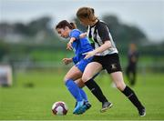 8 September 2019; Aoife Freyne of Manulla FC in action against Helen Cooney of Whitehall Rangers during the FAI Women's Intermediate Shield Final match between Manulla FC and Whitehall Rangers at Mullingar Athletic FC in Mullingar, Co. Westmeath. Photo by Seb Daly/Sportsfile