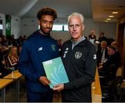 9 September 2019; Republic of Ireland manager Mick McCarthy presents Erik Oboli of the DDLETB Training Centre, Loughlinstown, with their certificate during the 2019 FAI-ETB Graduation event at the FAI Headquarters in Abbotstown, Dublin. Photo by Stephen McCarthy/Sportsfile