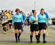 8 September 2019; Referee Sarah Dyas, centre, and her assistants Timara Lawless, left, and Olivia Sneyd leads the players out prior to the FAI Women's Intermediate Shield Final match between Manulla FC and Whitehall Rangers at Mullingar Athletic FC in Mullingar, Co. Westmeath. Photo by Seb Daly/Sportsfile