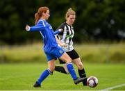 8 September 2019; Emma Cosgrave of Manulla FC in action against Helen Cooney of Whitehall Rangers during the FAI Women's Intermediate Shield Final match between Manulla FC and Whitehall Rangers at Mullingar Athletic FC in Mullingar, Co. Westmeath. Photo by Seb Daly/Sportsfile