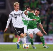 9 September 2019; Julian Brandt of Germany in action against Corry Evans of Northern Ireland during the UEFA EURO2020 Qualifier Group C match between Northern Ireland and Germany at the National Stadium at Windsor Park in Belfast. Photo by Ramsey Cardy/Sportsfile