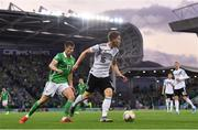 9 September 2019; Marcel Halstenberg of Germany in action against Paddy McNair of Northern Ireland during the UEFA EURO2020 Qualifier Group C match between Northern Ireland and Germany at the National Stadium at Windsor Park in Belfast. Photo by Ramsey Cardy/Sportsfile