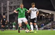 9 September 2019; George Saville of Northern Ireland in action against Joshua Kimmich of Germany during the UEFA EURO2020 Qualifier Group C match between Northern Ireland and Germany at the National Stadium at Windsor Park in Belfast. Photo by Ramsey Cardy/Sportsfile