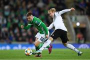 9 September 2019; Gavin Whyte of Northern Ireland in action against Julian Brandt of Germany during the UEFA EURO2020 Qualifier Group C match between Northern Ireland and Germany at the National Stadium at Windsor Park in Belfast. Photo by Ramsey Cardy/Sportsfile
