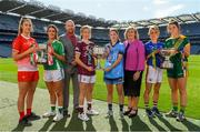 9 September 2019; In attendance at a photocall ahead of the TG4 All-Ireland Junior, Intermediate and Senior Ladies Football Championship Finals on Sunday next, are from left, Louth captain Kate Flood, Fermanagh captain Joanne Doonan, Rónán Ó Coisdealbha, Head of Sport, TG4, Galway captain Tracey Leonard, Dublin captain Sinéad Aherne, Marie Hickey, President, Ladies Gaelic Football Association, Tipperary captain Samantha Lambert and Meath captain Máire O'Shaughnessy. Photo by Ramsey Cardy/Sportsfile