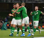 10 September 2019; James Collins of Republic of Ireland is congratulated by team-mates Enda Stevens, left, and James McClean, centre, after scoring his side's third goal during the 3 International Friendly match between Republic of Ireland and Bulgaria at Aviva Stadium, Dublin. Photo by Seb Daly/Sportsfile