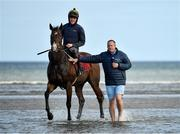 11 September 2019; Jockey Cody Keogh is interviewed by Niall Hannity of RacingTV while taking Plough Boy for a walk in the surf prior to the Laytown Strand Races in Laytown, Co Meath. Photo by Seb Daly/Sportsfile