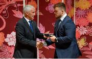 13 September 2019; Andrew Porter is presented with his RWC2019 cap by Deputy CEO of the Rugby World Cup Organising Committee Gerald Davies during the Ireland Rugby World Cup 2019 Welcome Ceremony at Mihama Bunka Hall Hall in Chiba Prefecture, Japan. Photo by Brendan Moran/Sportsfile
