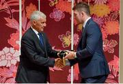 13 September 2019; Peter O'Mahony is presented with his RWC2019 cap by Deputy CEO of the Rugby World Cup Organising Committee Gerald Davies during the Ireland Rugby World Cup 2019 Welcome Ceremony at Mihama Bunka Hall Hall in Chiba Prefecture, Japan. Photo by Brendan Moran/Sportsfile