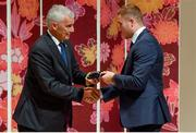 13 September 2019; Jordan Larmour is presented with his RWC2019 cap by Deputy CEO of the Rugby World Cup Organising Committee Gerald Davies during the Ireland Rugby World Cup 2019 Welcome Ceremony at Mihama Bunka Hall Hall in Chiba Prefecture, Japan. Photo by Brendan Moran/Sportsfile