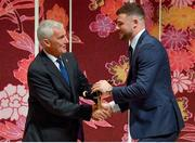 13 September 2019; Robbie Henshaw is presented with his RWC2019 cap by Deputy CEO of the Rugby World Cup Organising Committee Gerald Davies during the Ireland Rugby World Cup 2019 Welcome Ceremony at Mihama Bunka Hall Hall in Chiba Prefecture, Japan. Photo by Brendan Moran/Sportsfile