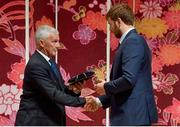13 September 2019; Iain Henderson is presented with his RWC2019 cap by Deputy CEO of the Rugby World Cup Organising Committee Gerald Davies during the Ireland Rugby World Cup 2019 Welcome Ceremony at Mihama Bunka Hall Hall in Chiba Prefecture, Japan. Photo by Brendan Moran/Sportsfile