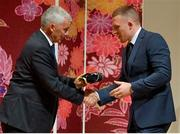 13 September 2019; Andrew Conway is presented with his RWC2019 cap by Deputy CEO of the Rugby World Cup Organising Committee Gerald Davies during the Ireland Rugby World Cup 2019 Welcome Ceremony at Mihama Bunka Hall Hall in Chiba Prefecture, Japan. Photo by Brendan Moran/Sportsfile