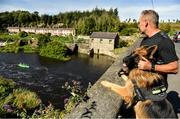 14 September 2019; Shay Griffin with his dog, Shadow, watch the on during The 60th Liffey Descent on the River Liffey at Lucan Weir in Lucan, Co Dublin. Photo by Seb Daly/Sportsfile