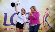 14 September 2019; Marie Hickey, President, LGFA, presents Aoife McAnespie of Emyvale, Co Monaghan with the Senior Championship Final trophy after they beat The Banner, Co Clare during the 2019 LGFA All-Ireland Club 7s at Naomh Mearnóg & St Sylvesters in Dublin. Photo by Michael P Ryan/Sportsfile