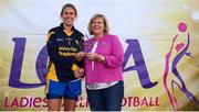 14 September 2019; Marie Hickey, President, LGFA, makes a presentation to Emma O'Driscoll of The Banner, Co Clare runners-up in the Senior Championship Final to Emyvale, Co Monaghan during the 2019 LGFA All-Ireland Club 7s at Naomh Mearnóg & St Sylvesters in Dublin. Photo by Michael P Ryan/Sportsfile