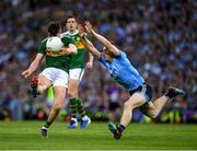 14 September 2019; Seán O'Shea of Kerry kicks a point, in the 45th minute, under pressure from John Small of Dublin during the GAA Football All-Ireland Senior Championship Final Replay match between Dublin and Kerry at Croke Park in Dublin. Photo by Ray McManus/Sportsfile