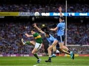 14 September 2019; David Moran of Kerry attempts to kick a point under pressure from Brian Fenton and Philip McMahon of Dublin during the GAA Football All-Ireland Senior Championship Final Replay match between Dublin and Kerry at Croke Park in Dublin. Photo by Seb Daly/Sportsfile