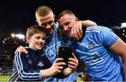 14 September 2019; Dublin supporter Adam McGrane, aged 10, from Malahide, Co. Dublin, takes a selfie with Paul Mannion, centre, and Ciarán Kilkenny of Dublin following the GAA Football All-Ireland Senior Championship Final Replay match between Dublin and Kerry at Croke Park in Dublin. Photo by Sam Barnes/Sportsfile