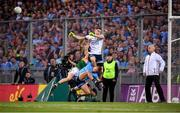 14 September 2019; Stephen Cluxton of Dublin clears the ball despite the pressure from Kerry's Stephen O'Brien and his Dublin team-mate Jonny Cooper during the GAA Football All-Ireland Senior Championship Final Replay between Dublin and Kerry at Croke Park in Dublin. Photo by Stephen McCarthy/Sportsfile