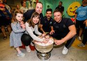 15 September 2019; Paul and Tracy Daly with their children Cara, age 3, and Ashling, age 9 weeks pictured with Dublin players Cian O'Sullivan, centre, and Rob McDaid on a visit by the All-Ireland Senior Football Champions to the Children's Health Ireland at Crumlin in Dublin. Photo by David Fitzgerald/Sportsfile