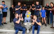 15 September 2019; Mary Rose O'Connell, age 12, from Co Waterford pictured with Dublin players, back row, from left, Con O'Callaghan, Cian O'Sullivan, Brian Howard, Rob McDaid and front row Jack McCaffrey, left, and Eoin Murchan and the Sam Maguire Cup on a visit by the All-Ireland Senior Football Champions to the Children's Health Ireland at Crumlin in Dublin. Photo by David Fitzgerald/Sportsfile