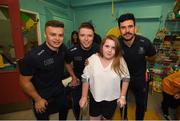 15 September 2019; Michelle McDonagh, age 11, from Rathcoole, Co Dublin pictured with Dublin players, from left, Eoin Murchan, Rob McDaid and Cian O'Sullivan on a visit by the All-Ireland Senior Football Champions to the Children's Health Ireland at Crumlin in Dublin. Photo by David Fitzgerald/Sportsfile