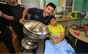 15 September 2019; Federico Rostas, age 10, pictured with Dublin player Cian O'Sullivan on a visit by the All-Ireland Senior Football Champions to the Children's Health Ireland at Crumlin in Dublin. Photo by David Fitzgerald/Sportsfile
