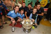 15 September 2019; Dublin players, from left, Rob McDaid, Cian O'Sullivan and Eoin Murchan pictured with Sean, age 12, and Cian Cummins age 7, and Patryk Muszka and the Sam Maguire cup on a visit by the All-Ireland Senior Football Champions to the Children's Health Ireland at Crumlin in Dublin. Photo by David Fitzgerald/Sportsfile