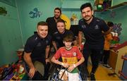 15 September 2019; Kevin Lambe, age 12, from Co Carlow, pictured with Dublin players, from left, Eoin Murchan, Rob McDaid and Cian O'Sullivan on a visit by the All-Ireland Senior Football Champions to the Children's Health Ireland at Crumlin in Dublin. Photo by David Fitzgerald/Sportsfile