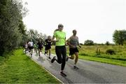 14 September 2019; Participants pictured at the Navan parkrun at Blackwater Park, in Navan, Co. Meath, where Vhi hosted a special event to celebrate their partnership with parkrun Ireland. Vhi ambassador and Olympian David Gillick was on hand to lead the warm up for parkrun participants before completing the 5km free event. Parkrunners enjoyed refreshments post event at the Vhi Rehydrate, Relax, Refuel and Reward areas. Parkrun in partnership with Vhi support local communities in organising free, weekly, timed 5k runs every Saturday at 9.30am. To register for a parkrun near you visit www.parkrun.ie.  Photo by Matt Browne/Sportsfile