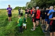 14 September 2019; David Gillick with Participants pictured at the Navan parkrun at Blackwater Park, in Navan, Co. Meath, where Vhi hosted a special event to celebrate their partnership with parkrun Ireland. Vhi ambassador and Olympian David Gillick was on hand to lead the warm up for parkrun participants before completing the 5km free event. Parkrunners enjoyed refreshments post event at the Vhi Rehydrate, Relax, Refuel and Reward areas. Parkrun in partnership with Vhi support local communities in organising free, weekly, timed 5k runs every Saturday at 9.30am. To register for a parkrun near you visit www.parkrun.ie.  Photo by Matt Browne/Sportsfile