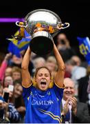15 September 2019; Tipperary captain Samantha Lambert lifts the Mary Quinn Memorial Cup following the TG4 All-Ireland Ladies Football Intermediate Championship Final match between Meath and Tipperary at Croke Park in Dublin. Photo by Stephen McCarthy/Sportsfile