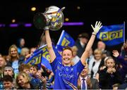 15 September 2019; Aishling Moloney of Tipperary lifts the Mary Quinn Memorial Cup following the TG4 All-Ireland Ladies Football Intermediate Championship Final match between Meath and Tipperary at Croke Park in Dublin. Photo by Stephen McCarthy/Sportsfile