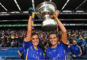 15 September 2019; Sisters Anna Rose Kennedy, left, and Caitlín Kennedy of Tipperary celebrate with the Mary Quinn Memorial Cup following the TG4 All-Ireland Ladies Football Intermediate Championship Final match between Meath and Tipperary at Croke Park in Dublin. Photo by Stephen McCarthy/Sportsfile
