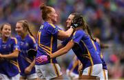 15 September 2019; Tipperary players Aishling Moloney, left, and Caitlín Kennedy celebrate after the TG4 All-Ireland Ladies Football Intermediate Championship Final match between Meath andTipperary at Croke Park in Dublin. Photo by Piaras Ó Mídheach/Sportsfile