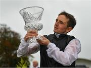 15 September 2019; Jockey Chris Hayes with the trophy after winning the Comer Group International Irish St Leger on Search For A Song during Day Two of the Irish Champions Weekend at The Curragh Racecourse in Kildare. Photo by Seb Daly/Sportsfile