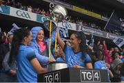 15 September 2019; Sinéad Goldrick, left, and Hannah O'Neill of Dublin lift the the Brendan Martin Cup with Freya Bohan, daughter of Dublin manager Mick Bohan, following the TG4 All-Ireland Ladies Football Senior Championship Final match between Dublin and Galway at Croke Park in Dublin. Photo by Ramsey Cardy/Sportsfile
