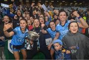 15 September 2019; Dublin players, from left, Kate Sullivan,Nicole Owens, captain Sinéad Aherne and Niamh McEvoy celebrate with the the Brendan Martin Cup following the TG4 All-Ireland Ladies Football Senior Championship Final match between Dublin and Galway at Croke Park in Dublin. Photo by Ramsey Cardy/Sportsfile