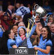 15 September 2019; Sinéad Goldrick, left, and Hannah O'Neill of Dublin lift the the Brendan Martin Cup with Freya Bohan, daughter of Dublin manager Mick Bohan, following the TG4 All-Ireland Ladies Football Senior Championship Final match between Dublin and Galway at Croke Park in Dublin. Photo by Stephen McCarthy/Sportsfile