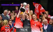 15 September 2019; Louth players, from left, Michelle McMahon, Una Pearson and Grace Treanor lift the West County Hotel Cup following the TG4 All-Ireland Ladies Football Junior Championship Final match between Fermanagh and Louth at Croke Park in Dublin. Photo by Stephen McCarthy/Sportsfile