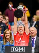 15 September 2019; Jennifer McGuinness of Louth lifts the West County Hotel Cup following the TG4 All-Ireland Ladies Football Junior Championship Final match between Fermanagh and Louth at Croke Park in Dublin. Photo by Stephen McCarthy/Sportsfile