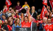 15 September 2019; Deirbhile Osborne of Louth lifts the West County Hotel Cup following the TG4 All-Ireland Ladies Football Junior Championship Final match between Fermanagh and Louth at Croke Park in Dublin. Photo by Stephen McCarthy/Sportsfile