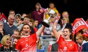 15 September 2019; Emily Norton and Aisling O'Doherty of Louth lift the West County Hotel Cup following the TG4 All-Ireland Ladies Football Junior Championship Final match between Fermanagh and Louth at Croke Park in Dublin. Photo by Stephen McCarthy/Sportsfile