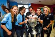 16 September 2019; Dublin ladies footballers, from left, Ciara Trant, Oonagh Whyte, Lyndsey Davey and Nicole Owens with Darragh Carroll, age 10 months, from Kilnamanagh, Co Dublin during the TG4 All-Ireland Senior Ladies Football Champions visit to Our Lady's Children's Hospital in Crumlin, Co Dublin. Photo by David Fitzgerald/Sportsfile